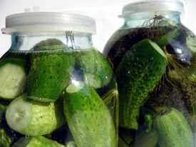Two glassy jars with cucumbers