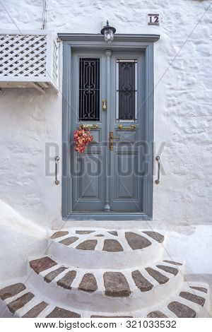 Entrance Door With Steps. Narrow Traditional White Street In The Town Of Hydra, Hydra Island, Greece