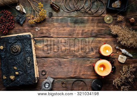 Magic Recipe Book And A Magic Potions On A Table. Witchcraft Background With Copy Space. Druid Or Wi