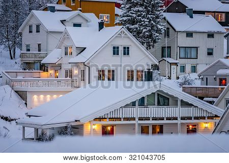 Residential Hillside Houses In Tromso Suburb Covered In A Deep Snow In Winter, Northern Norway