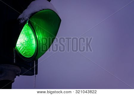 Green Traffic Lights Covered In Snow And Icicle During Blizzard And Snowfall, Tromso, Norway