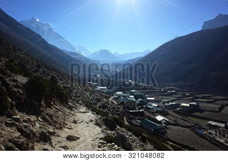 View of Dingboche village (4410 m) in early morning sun from the trail of Everest trek, Sagarmatha national park, Nepal