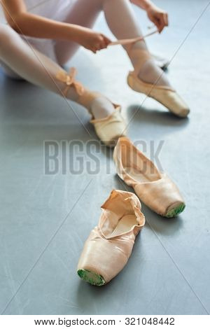 Pair Of Female Slippers For Ballet. Old Pointe Shoes For Ballet Dance. Studio Of Classical Ballet Da