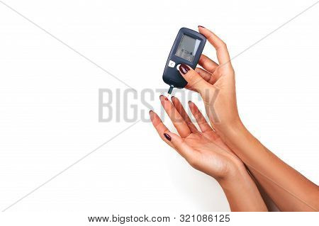 Diabetes Patient Poked Finger To Measure A Glucose Blood Level Test By New Smart Glucometer Isolated