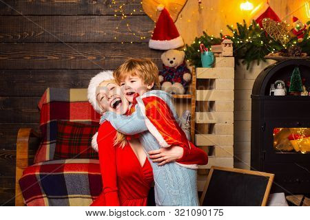 Mother And Little Child Boy Son Friendly Family Having Fun. Family Having Fun At Home Christmas Tree