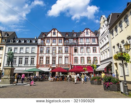 Koblenz, Germany - August 09, 2013: The Beautiful Sunlit Jesuit Square With Tourists And The Statue