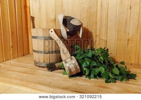 Interior details Finnish sauna steam room with traditional sauna accessories basin birch broom scoop felt hat. Traditional old Russian bathhouse SPA Concept. Relax country village bath concept poster