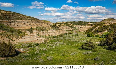 The Scenic Loop Road At Theodore Roosevelt National Park Offers Countless Spectacular Summertime Vie