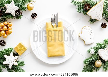 Table Setting With Spruce, Plate, Flatware On White Background Top View