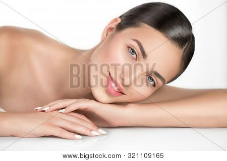 Beauty smiling young Woman with perfect fresh skin Portrait. Beautiful Spa Girl smiling on white background. Cleansing, skin care, body care concept. Skincare treatment, fresh clean skin