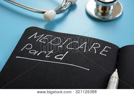 Medicare part d sign on the black page and stethoscope. poster