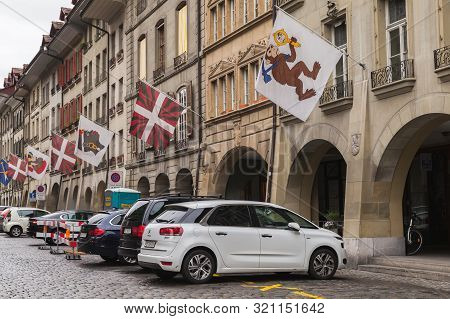 Bern, Switzerland - May 7, 2017: Street View Of Kramgasse Or Grocers Alley. Cars Are Parked Under Co