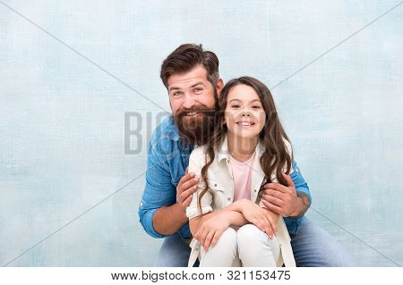 Strengthening father daughter relationships. Family hug. Father and daughter hug light background. Friendly relations. Fathers day concept. Lovely father and cute kid. Child and dad best friends. poster