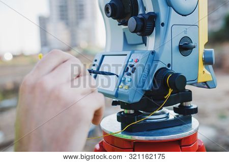 Geodesy. Landscaping. Landscape Work. Measurement Devices. Theodolite On A Tripod.