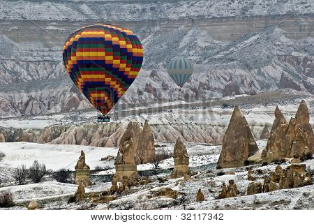 Hot Air Ballons flying on the sky of Cappadocia.