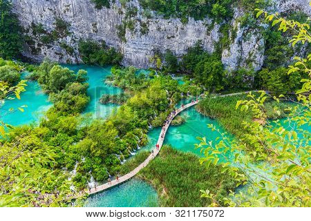 Plitvice Lakes, Croatia. Waterfalls And Wooden Pathway Of Plitvice Lakes National Park.