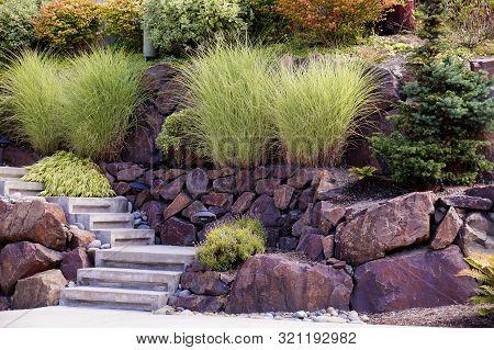 Rock Garden On The Slope. Strengthening The Escarpment At The House.