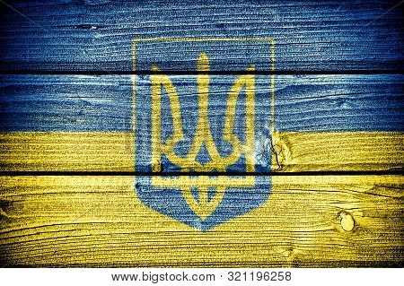 Flag Of Ukraine Painted On Old Grungy Wooden  Background