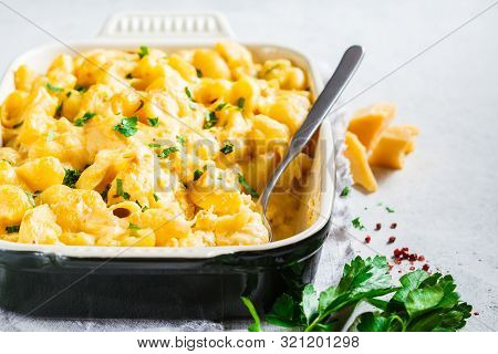 Mac And Cheese In The Oven Dish, White Background.