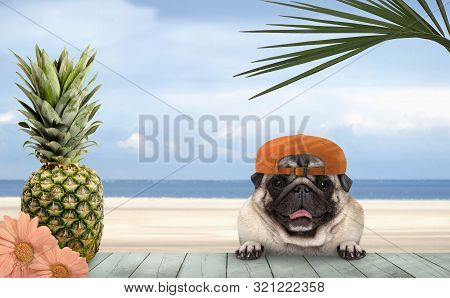 Smiling Tropical Summer Pug Dog With Orange Cap, With Paws On Vintage Green Wooden Table And Sea And