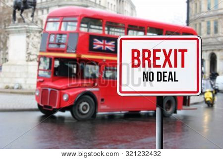 Blurred London Street View With Red Double Decker Bus And Brexit No Deal Sign In Rainy Day. Possible