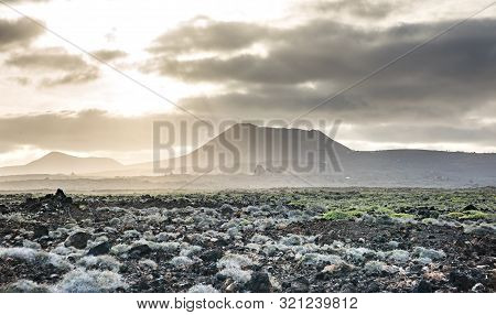 Beautiful Mountain Landscape With Volcanoes At Sunset In Timanfaya National Park In Lanzarote, Canar