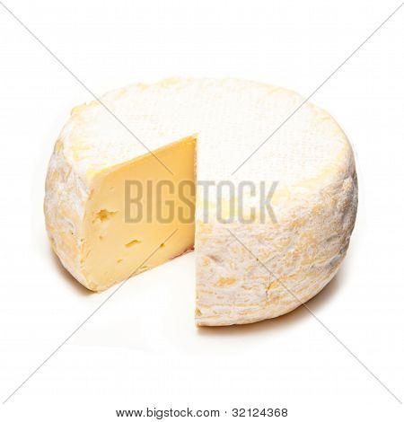 Petit Reblochon Cheese Isolated On A White Studio Background.