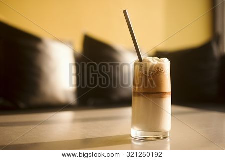 Delicious Iced Coffee Latte With Whipped Cream Is Sreved On Table.