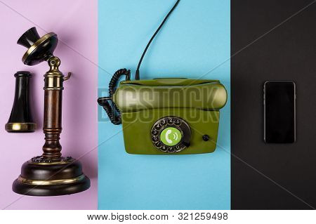 Old Brown Vintage Telephone Along With A Wired Green Telephone And Mobile Phone On Various Color Bac