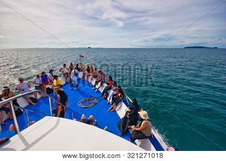 ANDAMAN SEA, THAILAND- JULY 22, 2007: tourists on the top deck of ship sailing from Phuket island to Phi Phi Island. Phi Phi island near the coast of Thailand, between the mainland and Phuket island