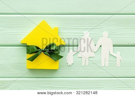 Apartment Purchasing With House Figure On Mint Green Wooden Background Top View