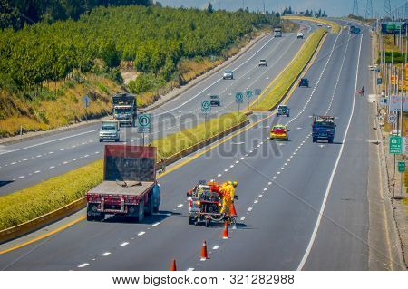 Cotopaxi, Ecuador - 08 September 2019: Workmen Painting Lines On Road. Road Line Car Painting White