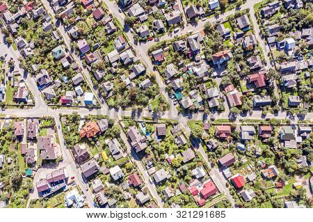 Aerial Top View Flying Over City Residential Area With Real Estate Houses And Gardens