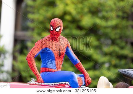 Louisville, Kentucky, Usa - May 2, 2019: The Pegasus Parade, Man Dress Up As Spiderman, Riding On A