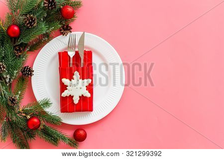 Table Setting With Spruce, Plate, Flatware On Pink Background Top View Mockup