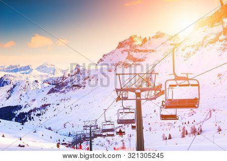 Ski Lift On Ski Resort In Winter Dolomite Alps. Val Di Fassa Ski Resort, Italy. Winter Landscape