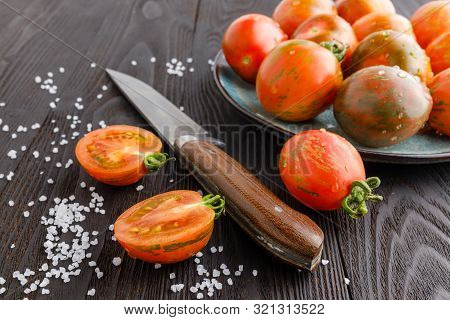 Red Tomatoes With Dill On A Wooden Board. Home Cooking