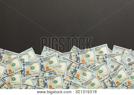 Top View Banknotes On Colored Desk With Copy Space On Top. One Hundred Dollar Bills With Stack Of Mo
