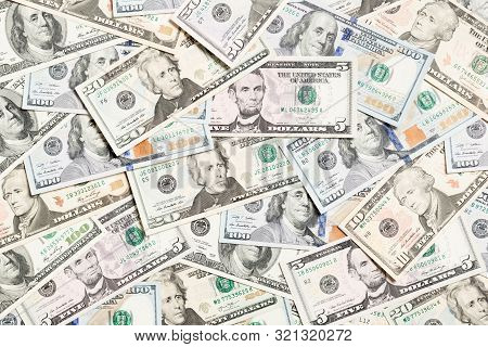 Top View Of Various Dollar Cash Background. Different Banknotes Concept. Wealth And Rich Concept