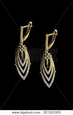 Elegant Gold Diamonds Earrings On Black Background