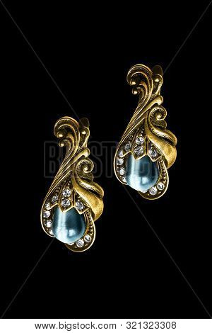 Pair Of Vintage Gold Earrings With Gems And Crystals Isolated Over Black