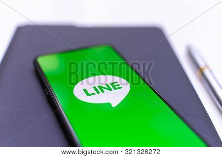 Chiang Mai, Thailand - May.26,2019: Xiaomi Mi Mix 3 Mobile Phone With Line Apps On Screen On White T