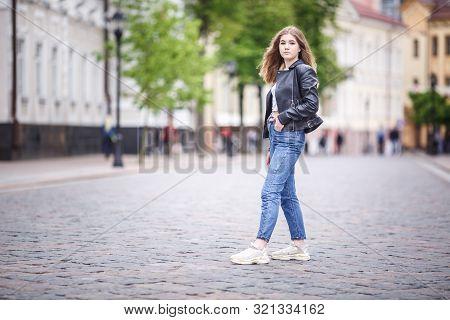 Portrait Of Little Beautiful Stylish Kid Girl In City Urban Street