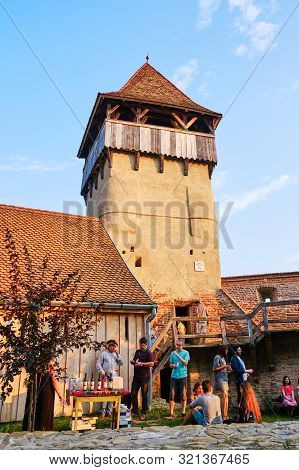 Alma Vii, Romania - July 27, 2019: People At A Brunch And Wine Tasting Gathering In The Fortified Ch