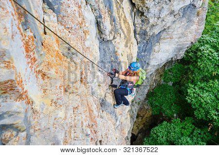 Woman Climber On A Via Ferrata Route Called Dragons Amphitheater (amfiteatrul Zmeilor) In Baia De Fi