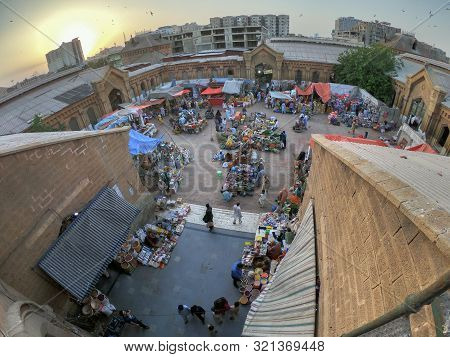 Top View Of People Selling Different Things In The Beautiful Architecture Of Empress Market Karachi