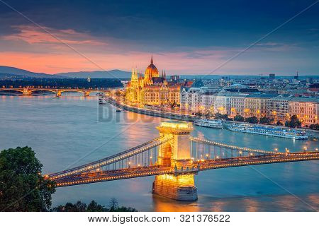 Budapest, Hungary. Aerial Cityscape Image Of Budapest With Chain Bridge And Parliament Building Duri
