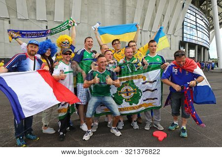 Lyon, France - June 16, 2016: Ukrainian And Northern Irish Fans Pose For A Group Photo Before The Ue