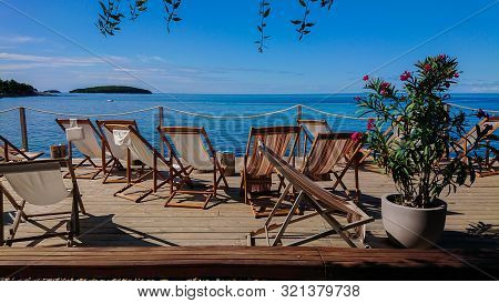 Wooden Floor With Chaise-longues And Tables In Istria, Croatian Coast
