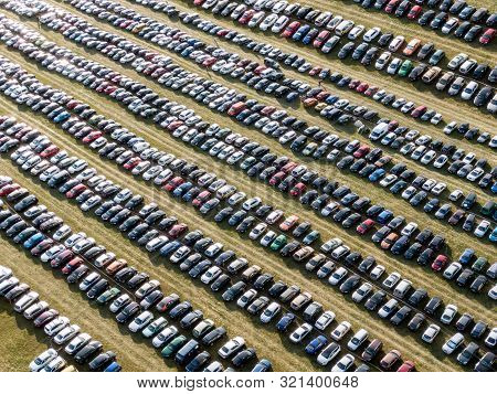 Many Cars Parked In The Field. Car Background.
